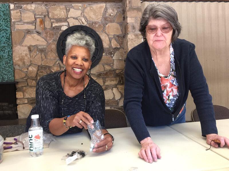 Yvonne Warren and Karen Crete arranging supplies for the October Bead Study meeting at Shepard Garden & Arts Center